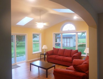 Newly Finished Sunroom Addition with grand archway