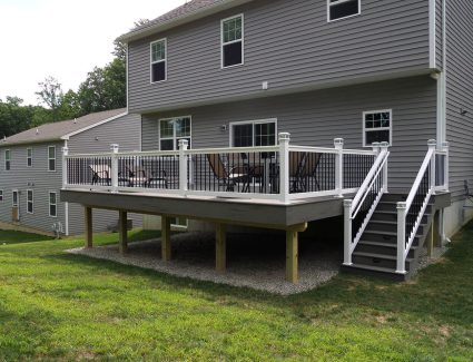 Custom Vinyl Deck with Stairs built by deck contractors in pa