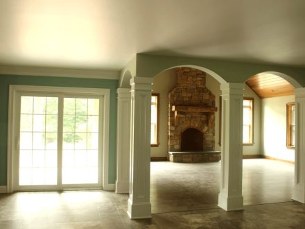 interior home remodeling project including a brick fireplace and small archways