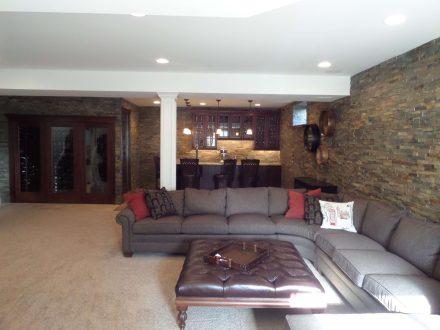 Basement Remodel with Bar and stone walls
