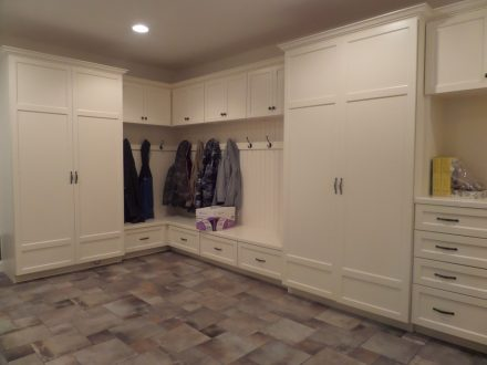 laundry room with built-in lockers and cabinets