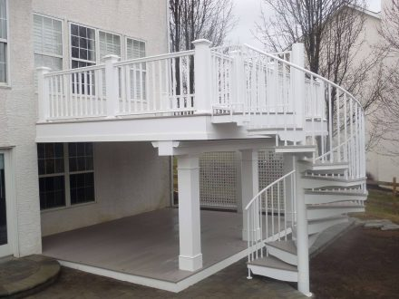 custom white vinyl decking with railing and spiral staircase