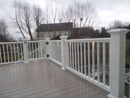 Custom White Vinyl railing and Deck