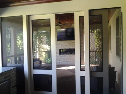 Full Outdoor Kitchen with Sliding Doors to Screened-In-Porch
