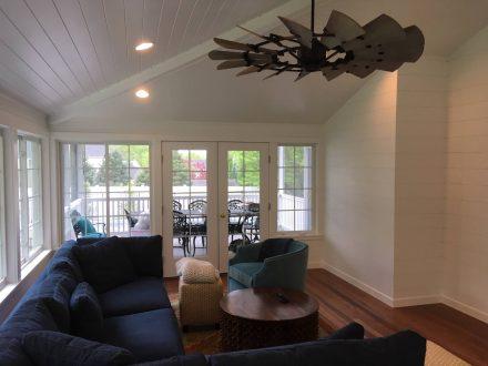custom living room home remodel with huge windows