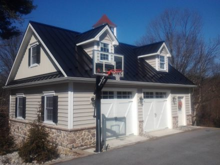 attached home custom garage addition with basketball hoop
